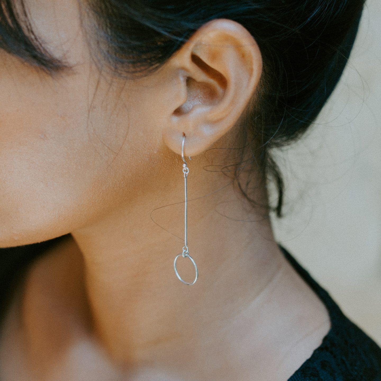 Woman Wearing Silver-colored Earring