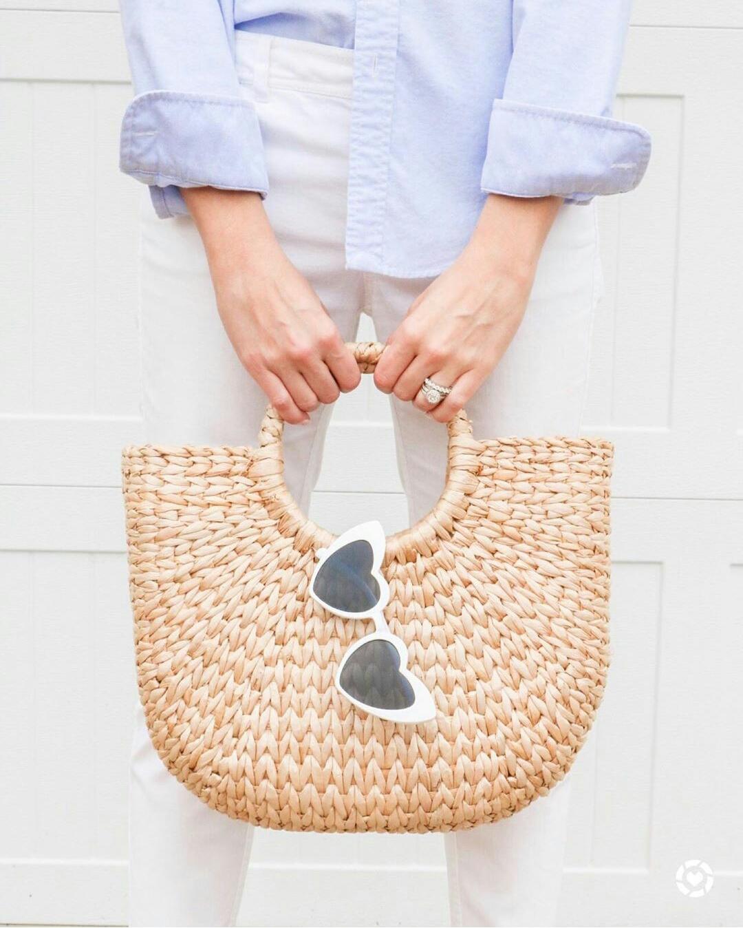 straw bag and sunglasses