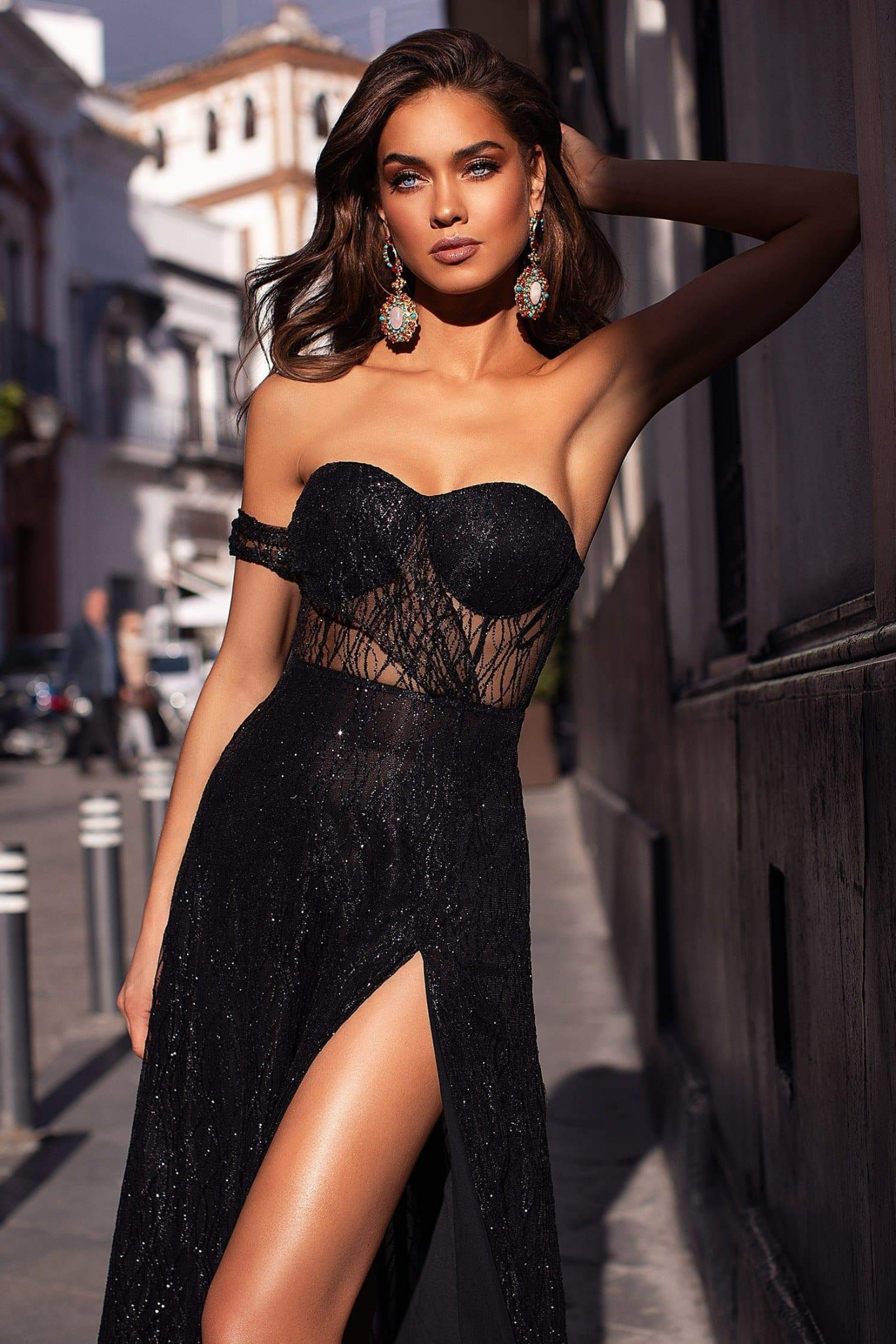 Young woman in a gorgeous black evening dress for a black-tie event